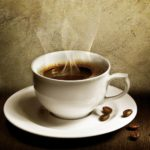 steaming-cup-of-coffee-with-coffee-beans-spilled-copy